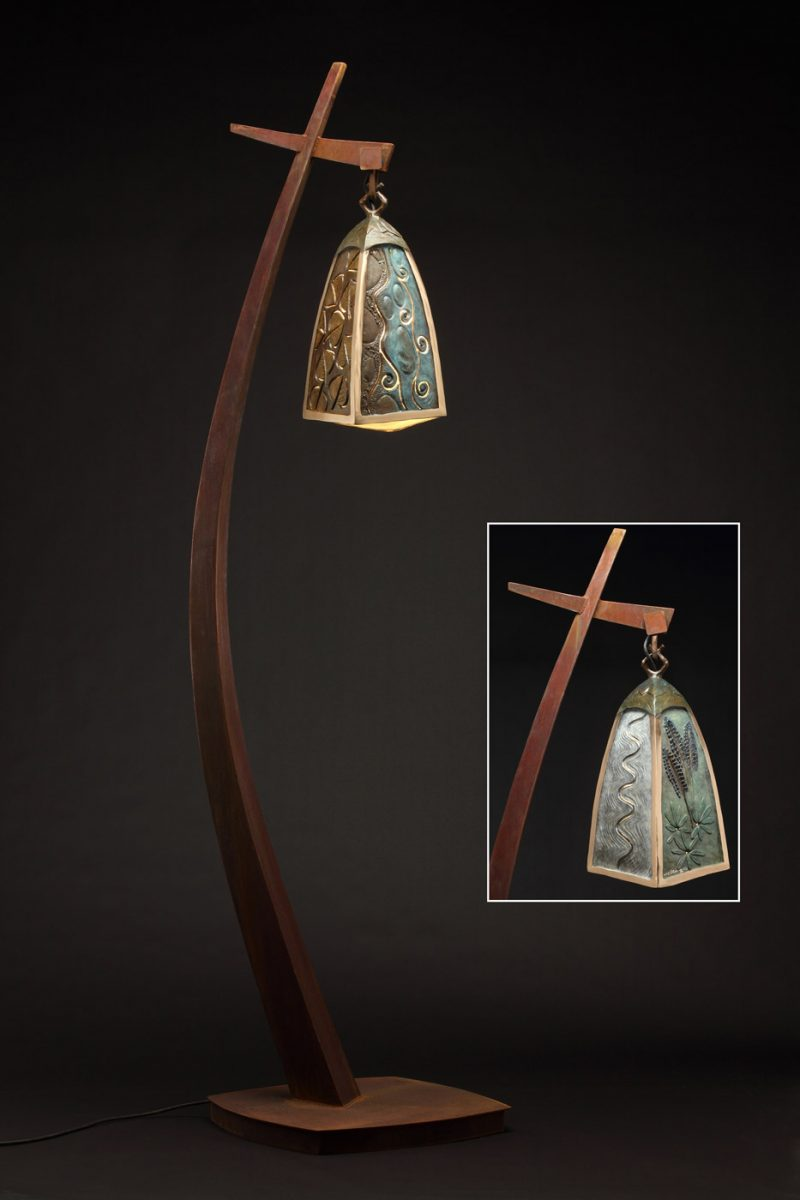 Tall bronze lamp by Colorado artist JG Moore for the city of Vail